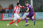 Chris Clements and Jake Hessenthaler  during the EFL Sky Bet League 2 match between Cheltenham Town and Grimsby Town FC at LCI Rail Stadium, Cheltenham, England on 8 December 2018.