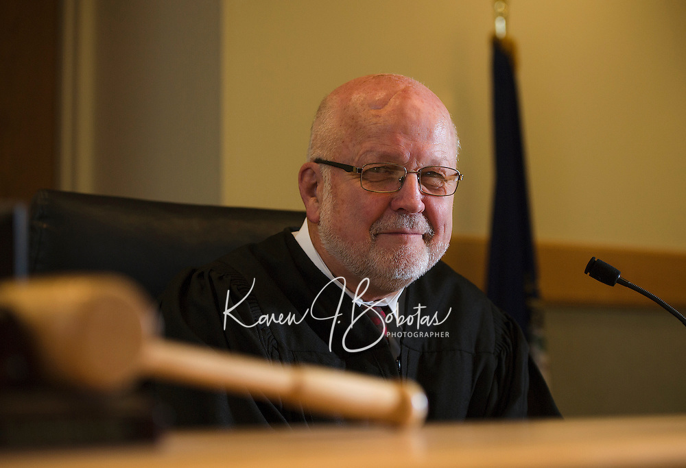 Judge James Carroll seated at the bench in Laconia District Court.  (Karen Bobotas/Photographer)