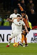 Adam Forshaw of Leeds United goes past Fraizer Campbell of Hull City during the EFL Sky Bet Championship match between Hull City and Leeds United at the KCOM Stadium, Kingston upon Hull, England on 30 January 2018. Photo by Paul Thompson.