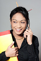 cute funny young expressive women asian working woman at the office calling by phone
