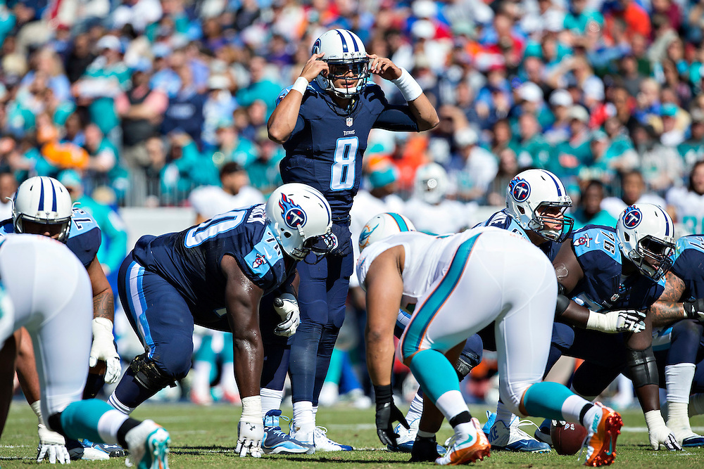 NASHVILLE, TN - OCTOBER 18:  Marcus Mariota #8 of the Tennessee Titans over center during a game against the Miami Dolphins at LP Field on October 18, 2015 in Nashville, Tennessee.  The Dolphins defeated the Titans 38-10.  (Photo by Wesley Hitt/Getty Images) *** Local Caption *** Marcus Mariota