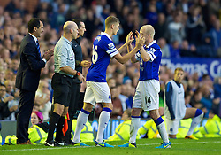 LIVERPOOL, ENGLAND - Saturday, September 14, 2013: Everton's substitute John Stones replaces Chelsea's Steven Naismith during the Premiership match against Chelsea at Goodison Park. (Pic by David Rawcliffe/Propaganda)