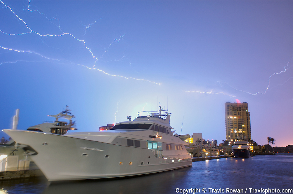 Luxury yachts docked under a lightning filled sky in Ft. Lauderdale, Florida.