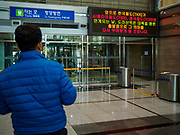PAJU, GYEONGGI, SOUTH KOREA: A South Korean tourist looks at the departure gate for trains to North Korea at Dorasan Station on the South Korean edge of the DMZ. The station was built in the early 2000s during a thaw in relations between the Koreas. It has never been used and is now a tourist site. Tourism to the Korean DeMilitarized Zone (DMZ) has increased as the pace of talks between South Korea, North Korea and the United States has increased. Some tours are sold out days in advance.      PHOTO BY JACK KURTZ