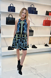TESS WARD at the launch of the new Giusepe Zanotti store in Conduit Street, London on 26th October 2016.