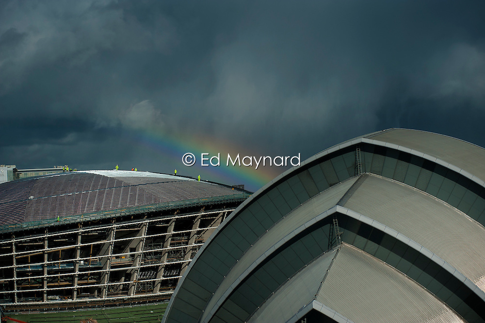 Rainbow over the roof of The Hydro currently under construction on the site of the SECC (Scottish Exhibition and Conference Centre), Glasgow, Scotland, UK.