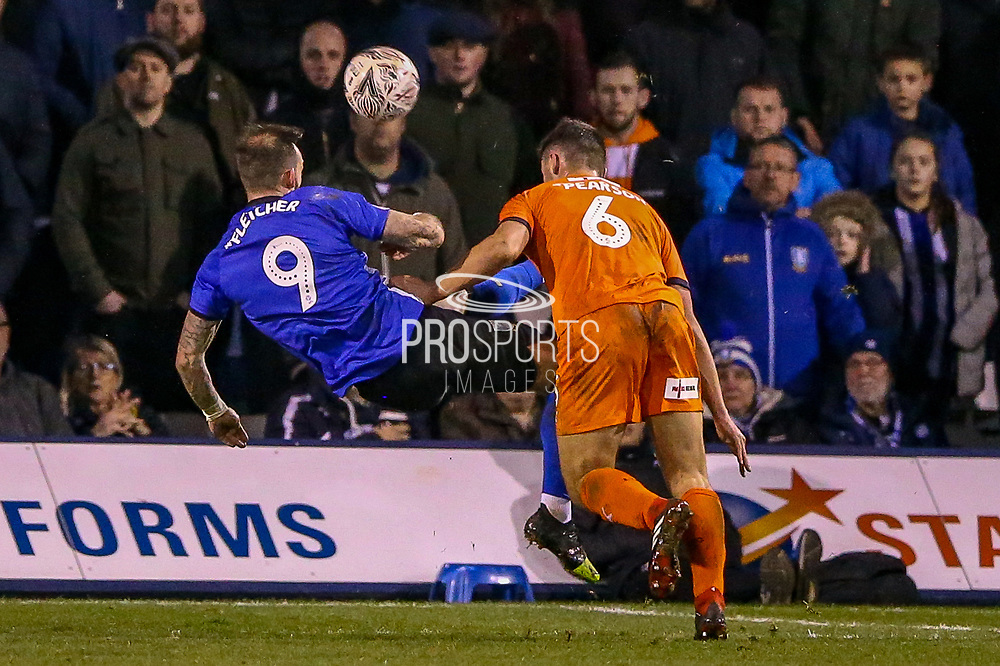 Sheffield Wednesday forward Steven Fletcher (9) with an acrobatic kick during the The FA Cup 3rd round replay match between Luton Town and Sheffield Wednesday at Kenilworth Road, Luton, England on 15 January 2019.