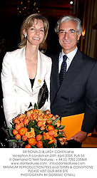 SIR RONALD & LADY COHEN at a reception in London on 24th April 2003.	PJA 54