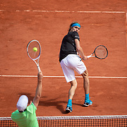 PARIS, FRANCE May 28.  Alexander Zverev of Germany takes evasive action as John Millman of Australia smashes the ball at the net on Court Philippe-Chatrier in the Men's Singles first round match at the 2019 French Open Tennis Tournament at Roland Garros on May 28th 2019 in Paris, France. (Photo by Tim Clayton/Corbis via Getty Images)