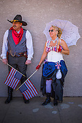 30 JUNE 2012 - PRESCOTT, AZ:  NORM MULLENIX, left, and PAT BLAKEY, members of the Prescott Regulators & Their Shady Ladies, an old west reenactors group, wait to march in the Prescott 4th of July Parade. The Prescott Frontier Days Rodeo Parade is marking its 125th year. It is one of the largest 4th of July Parades in Arizona. Prescott, about 100 miles north of Phoenix, was the first territorial capital of Arizona.    PHOTO BY JACK KURTZ