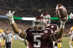 Texas A&M running back Trayveon Williams (5) celebrates a touchdown against LSU during the third quarter of an NCAA college football game Thursday, Nov. 24, 2016, in College Station, Texas. (Sam Craft/The Eagle)
