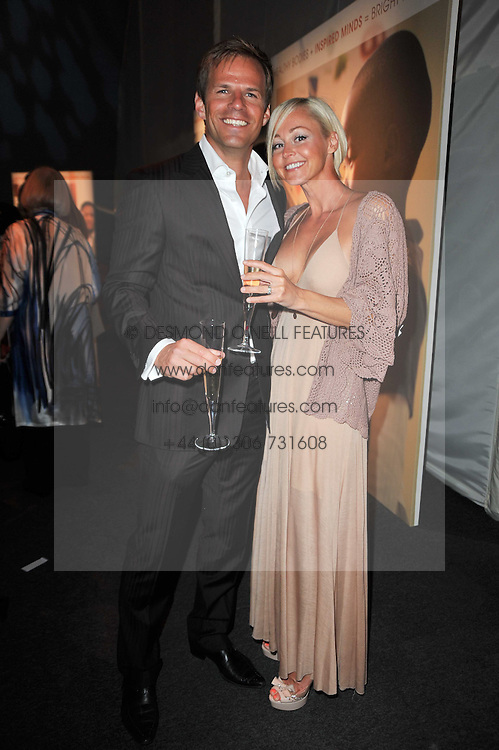 Actor BEN RICHARDS and his wife HELEN at a gala evening in aid of Ubuntu Education Fund held at Battersea Power Station, London on 4th May 2011.