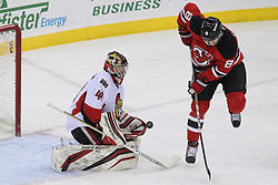 Apr 7; Newark, NJ, USA; New Jersey Devils right wing Dainius Zubrus (8) tips the puck wide of Ottawa Senators goalie Craig Anderson (41) during the second period at the Prudential Center.