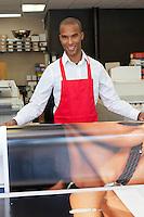 Industrial worker taking printouts