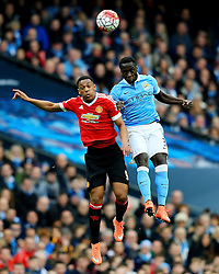 Anthony Martial of Manchester United jumps for a header with Bacary Sagna of Manchester City  - Mandatory byline: Matt McNulty/JMP - 20/03/2016 - FOOTBALL - Etihad Stadium - Manchester, England - Manchester City v Manchester United - Barclays Premier League