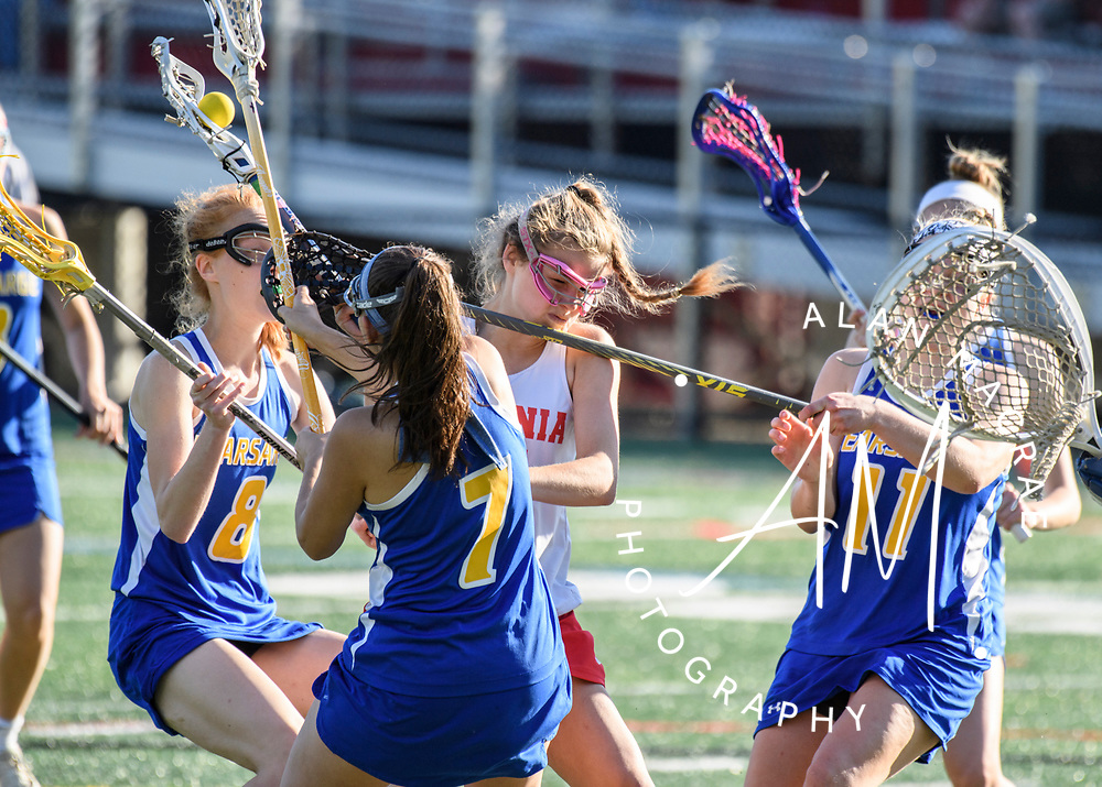 Laconia's Skyler Tautkus pushes through a tough Kearsarge defense during a game at Fitzgerald Field on Thursday, June 1, 2017.  (Alan MacRae for the Laconia Daily Sun)