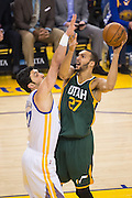 Golden State Warriors center Zaza Pachulia (27) defends Utah Jazz center Rudy Gobert (27) at the basket during the first quarter at Oracle Arena in Oakland, Calif., on December 20, 2016. (Stan Olszewski/Special to S.F. Examiner)