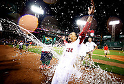 Mookie Betts #50 of the Boston Red Sox is doused in water after hitting a walk off two run double to defeat the St. Louis Cardinals 5-4 at Fenway Park on August 16, 2017 in Boston, Massachusetts.
