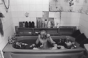 Little kid in the bath, Newport, South Wales, 2000's