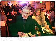 Lucian Freud sitting in the front row  Bella Freud's fashion show. Cafe Royal. London23 February 1998. film 98849f28<br /> © Copyright Photograph by Dafydd Jones<br /> 66 Stockwell Park Rd. London SW9 0DA<br /> Tel 0171 733 0108