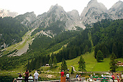 Austria, Upper Austria, Gosau, Lake Gosau in the Dachstein Mountains tourists admiring the view