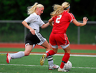1 MAY 2010 -- O'FALLON, MO. -- Francis Howell North High School girls' soccer player Cindy Lackey (14) rushes to block a shot attempt by Ursuline Academy;s Bridget Brotherton (2) during the championship game of the 19th Annual St. Dominic / Howell North Shootout Saturday, May 1, 2010 at St. Dominic High School in O'Fallon, Mo. Ursuline beat Howell North 2-1. Photo © copyright 2010 by Sid Hastings.