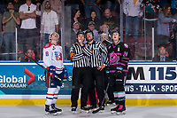 KELOWNA, BC - SEPTEMBER 21:  Jake McGrew #8 of the Spokane Chiefs, referees Sean Raphael and Nick Panter, linesman Dustin Minty and Kyle Topping #24 of the Kelowna Rockets stand in front of the officials box watching the replay on the jumbotron at Prospera Place on September 21, 2019 in Kelowna, Canada. (Photo by Marissa Baecker/Shoot the Breeze)