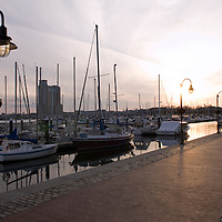 Sunset waterfront views along Lancaster Street in the Inner Harbor East neighborhood, on the fringes of Fells Point, Baltimore, Maryland, USA.