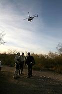 Border patrol agents chase drug traffickers .Tucson, AZ.12/8/05.photos: Hector Emanuel