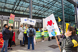 London, UK. 21 May, 2019. Cleaners belonging to the Public & Commercial Services Union (PCS) and working at the Department for Business, Energy and Industrial Strategy (BEIS) via contractors ISS and Aramark stand on the picket line outside the Government department after voting decisively to take industrial action for four days to demand the London Living Wage and an end to outsourcing.