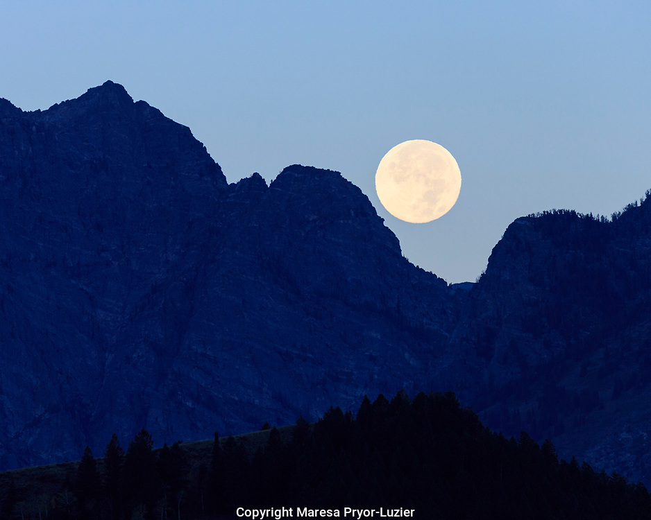 Super moon setting over the Grand Teton Mountain Range, Grand Teton National Park, Wyoming