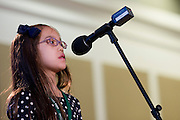 Lillian Nguyen spells a word during the Southeast Ohio Regional Spelling Bee Saturday, March 16, 2013. The Regional Spelling Bee was sponsored by Ohio University's Scripps College of Communication and held in Margaret M. Walter Hall on OU's main campus.