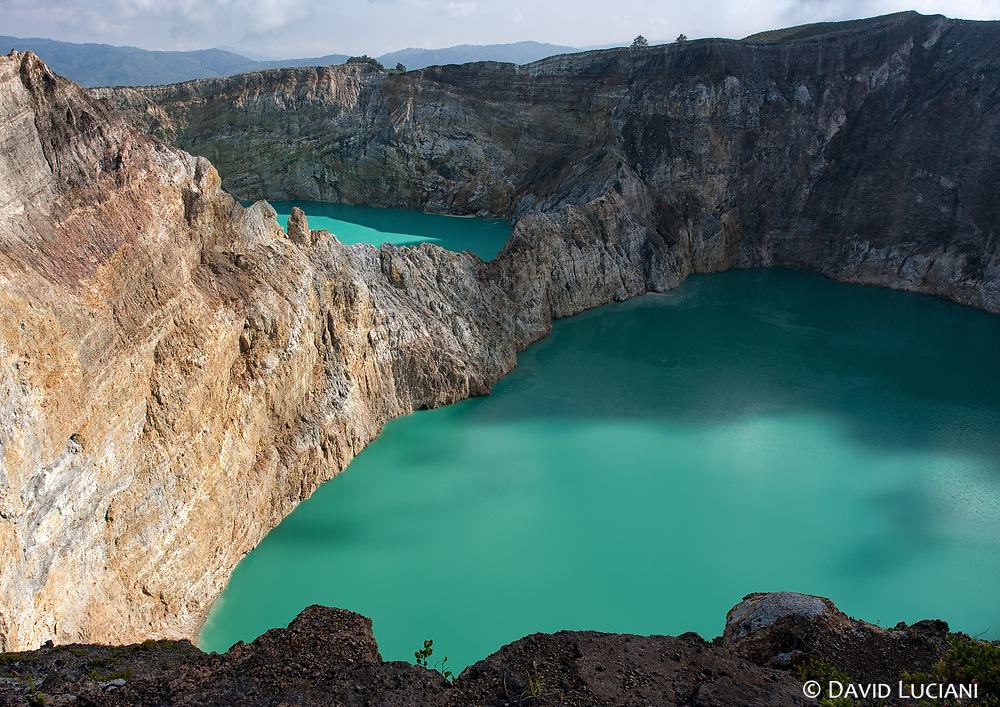 """Two of the three lakes in Kelimutu National Park. Behind you can see """"Tiwu Nuwa Muri Koo Fai"""" (Lake of Young Men and Maidens) and """"Tiwu Ata Polo"""" (Bewitched or Enchanted Lake) in the foreground."""