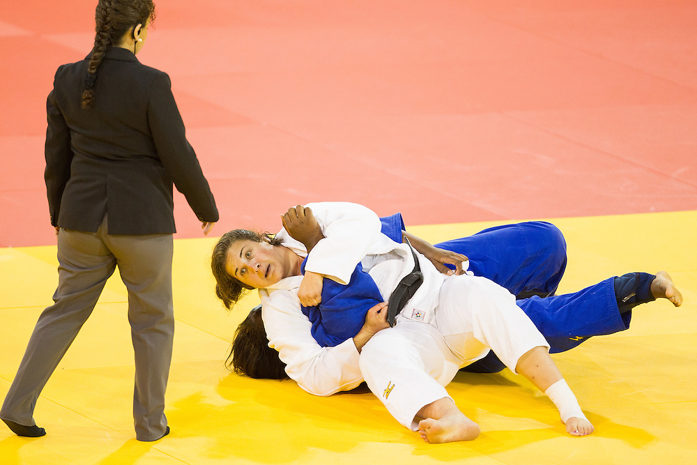 Nina Cutro-Kelly of the United States pins  Leidi German (L) of the Dominican Republic to win their 1/4 final contest in the women's judo +78kg class at the 2015 Pan American Games in Toronto, Canada, July 14,  2015.  AFP PHOTO/GEOFF ROBINS