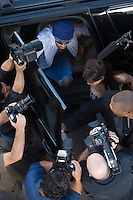 Male celebrity and paparazzi high angle