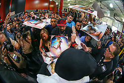 Los Angeles, California, USA - February 25, 2015: Ronda Rousey signs autographs for fans after working out at the UFC Gym for her upcoming bout against Cat Zingano at UFC 184 at the Staples Center in Los Angeles, California.  Ed Mulholland for ESPN