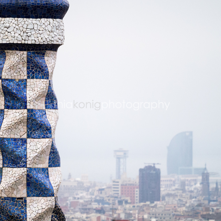 A View of Barcelona from Park Guell with mosaic sculpture in forground - designed by architect Gaudi.