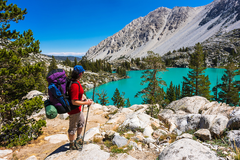 Backpacker at First Lake, Big Pine Lakes, John Muir Wilderness, California USA