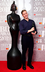 George Ezra with his Best British Male Solo Artist Brit Award in the press room at the Brit Awards 2019 at the O2 Arena, London.