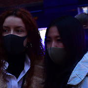 People in London Chinatown wearing Wuhan masks and is become a fashion and is to keep the face warm nothing to do with coronavirus one say, foreigner has many disease killed a lot of people from sextual disease, aid and flu on 25th January 2020, London, UK.