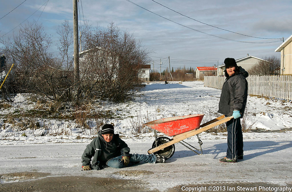 Children play in the street. Three-quarters of Attawapiskat's population is under the age of 35.<br /> <br /> (Ian Stewart photo)