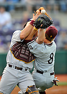 MANHATTAN, KS - MAY 06:  MANHATTAN, KS - May 06:  Catcher Petey Paramore #13 of the Arizona State Sun Devils collides with first basemen Mike Leake #8 during a pop fly foul off the bat of shortstop Drew Biery of the Kansas State Wildcats in the second inning on May 06, 2008 at Tointon Stadium in Manhattan, Kansas.  (Photo by Peter Aiken/Getty Images) *** Local Caption *** Petey Paramore; Mike Leake