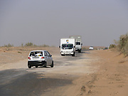 Uzbekistan, Bukhara Province. Through the desert along the A380 from Bukhara to Khiva. Wandering dunes on the road.