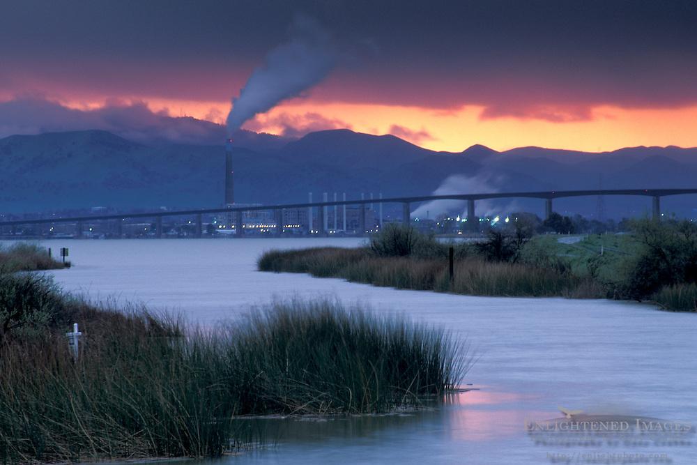 Storm clouds at sunset over Antioch Bridge, from Sherman Island, Sacramento San Joaquin River Delta, California