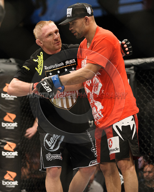 OBERHAUSEN, GERMANY, NOVEMBER 13, 2010: Dennis Siver and Andre Winner during UFC 122 inside the Konig Pilsner Arena in Oberhausen, Germany.