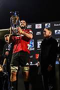 Milton Samios of Investec Australia  hands Sam Whitelock the Super Rugby Trophy with during the Super Rugby Final, Crusaders V Lions, AMI Stadium, Christchurch, New Zealand, 4th August 2018.Copyright photo: John Davidson / www.photosport.nz