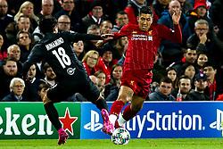 Roberto Firmino of Liverpool takes on Takumi Minamino of FC Salzburg - Mandatory by-line: Robbie Stephenson/JMP - 02/10/2019 - FOOTBALL - Anfield - Liverpool, England - Liverpool v Red Bull Salzburg - UEFA Champions League Group Stage