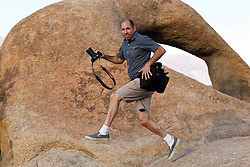 Photographer jumping past the Alabama Hills Arch, Lone Pine, California, United States of America