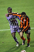 Luiz Adriano shields the ball from Danny Nounkeu. Toulouse v Shakatar Donestk, Uefa Europa League, Stade Municipal, Toulouse, France, 5th November 2009.