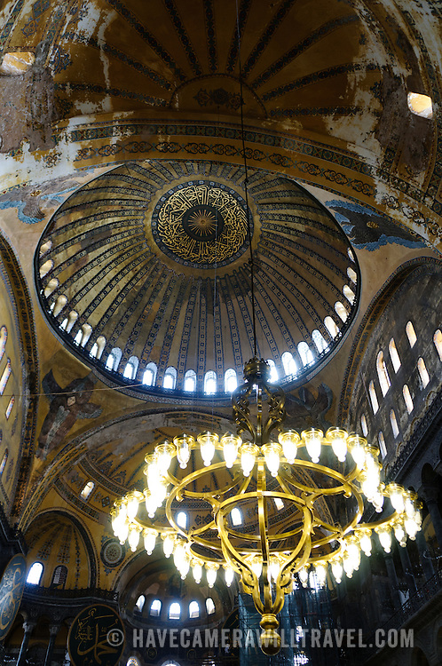 Haghia sophia interior with suspended chandeliers have camera will originally built as a christian cathedral then converted to a muslim mosque in the 15th aloadofball Images